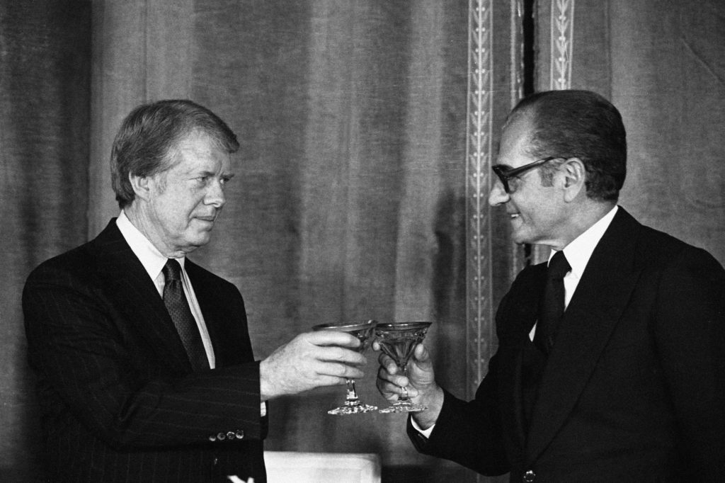 31 Dec 1978, Tehran, Iran --- American President Jimmy Carter and Shah Reza Pahlavi of Iran toast following a formal dinner in the Niavaran Palace in Tehran, Iran. --- Image by © Bettmann/CORBIS